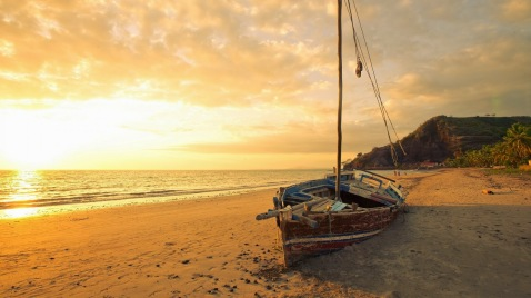 old-sailboat-on-a-beautiful-beach-at-sun